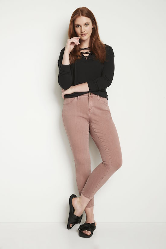 Woman wearing Curvy Skinny Jeans in Pink