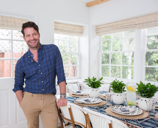 Nate Berkus next to his completed table