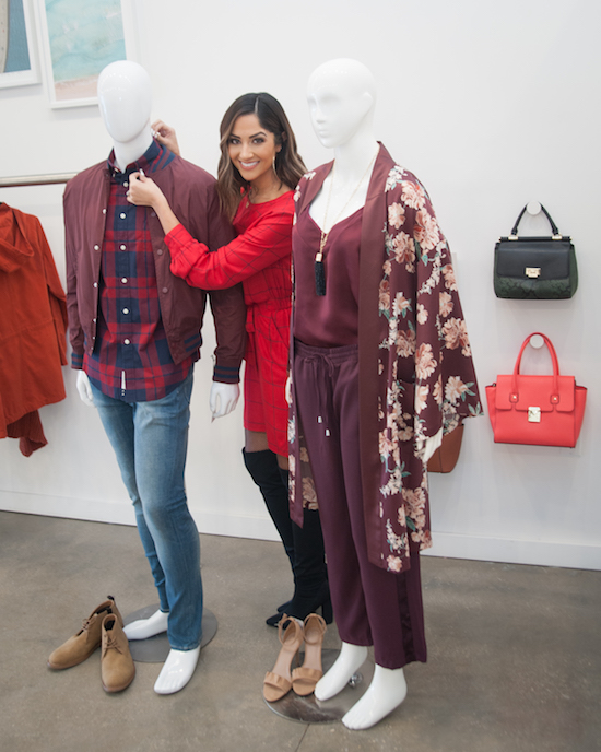 Karla styling two mannequins in shades of red
