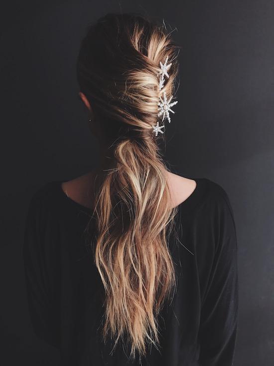 French twist-inspired pony tail with star-shaped hair accessories