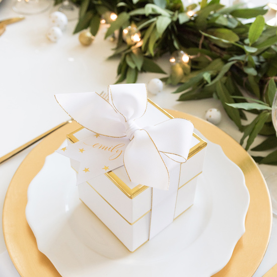 Small white gift box on place setting