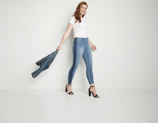 Woman wearing high rise jegging in tuxedo wash