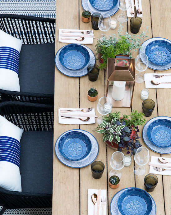 Tablescape with blue plates and gold flatware