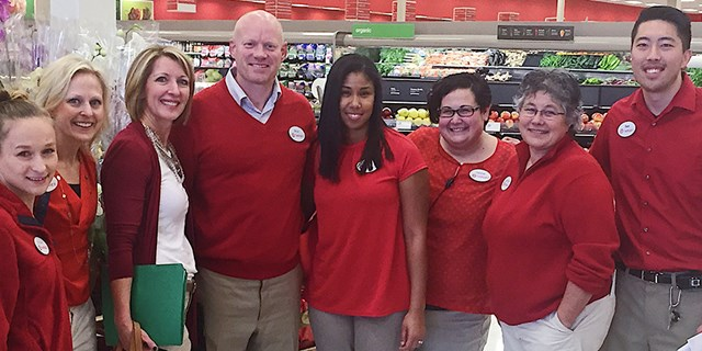 Stephanie Lundquist (third from left) with a store team