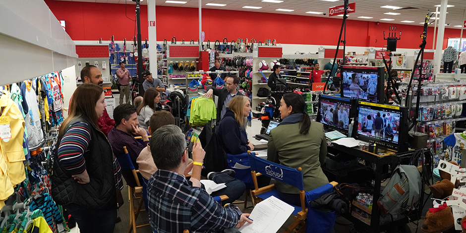 The cast and crew filming inside a Target store