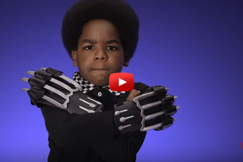 A little boy wears Black Panther claw toys