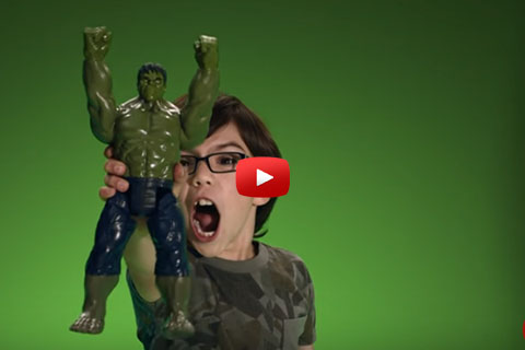 A little boy holds a Hulk action figure