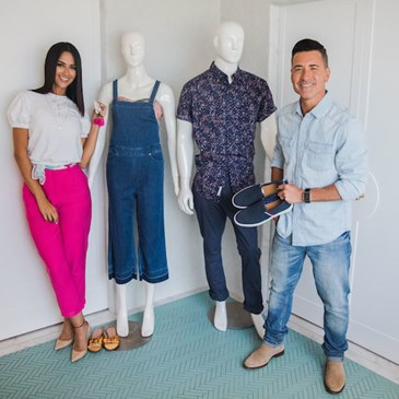 Karla and Jorge standing with styled models