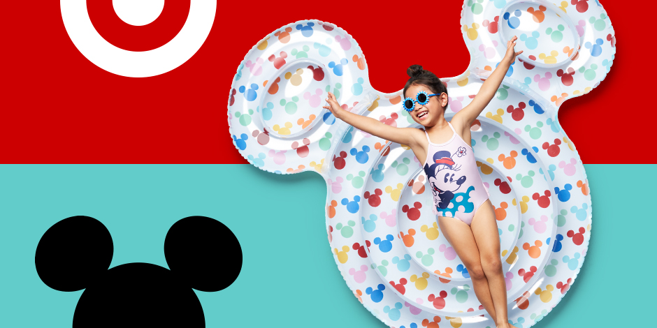 A girl in a Mickey swimsuit and sunglasses floats on a Mickey-ear-shaped inflatable.