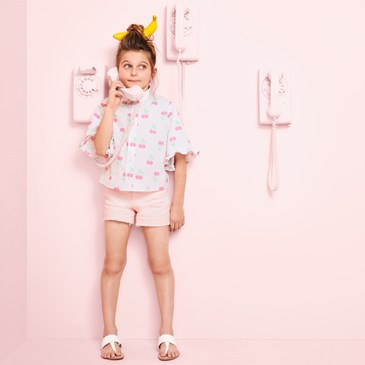Kid model wearing new Museum of Ice Cream Art Class collection