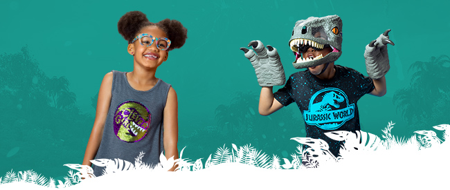 A little girl and boy dressed in Jurassic World shirts. The boy also wears a dinosaur mask and claws.