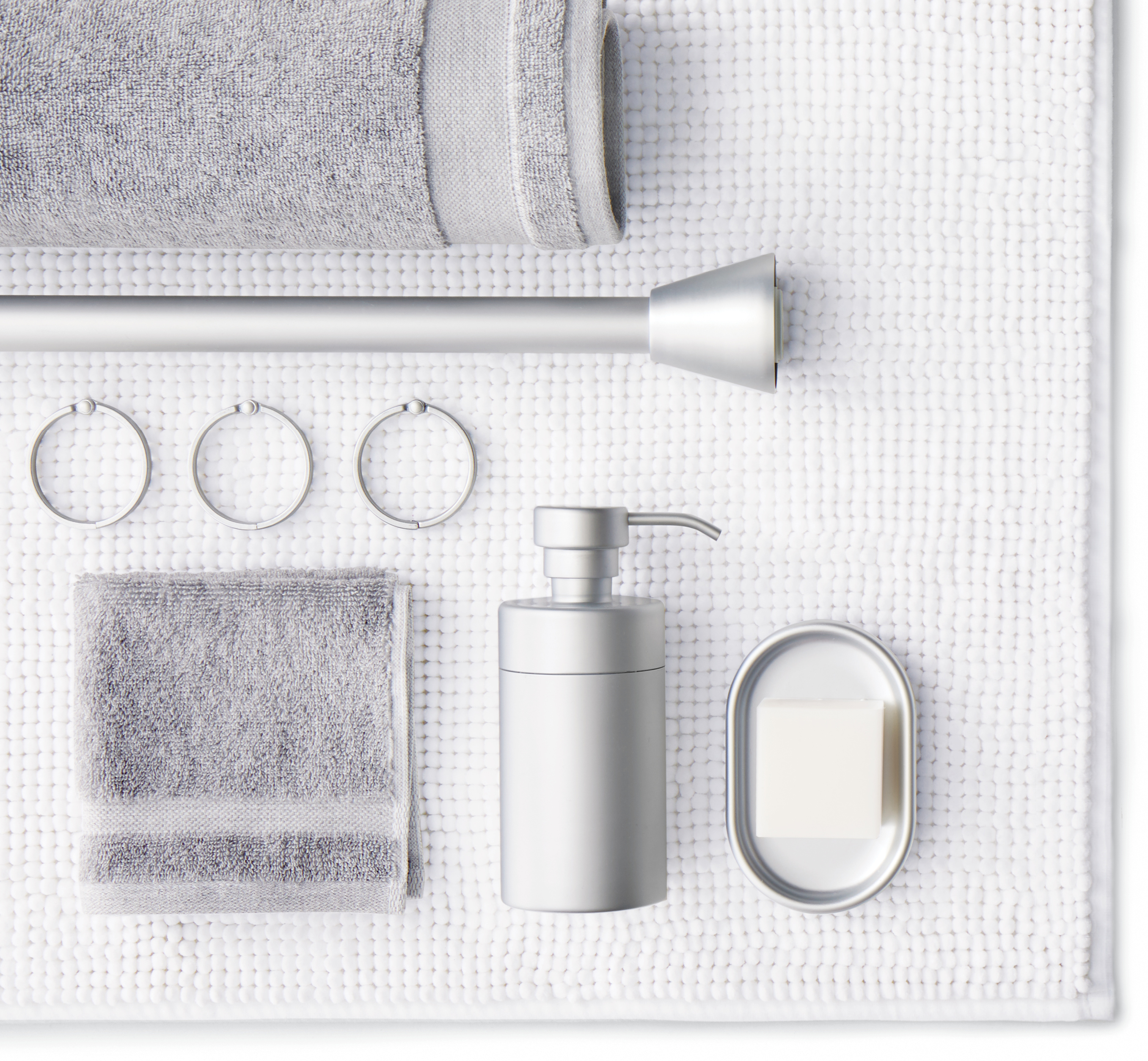 Collage including grey bath and hand towels, shower rod and rings, soap pump and dish