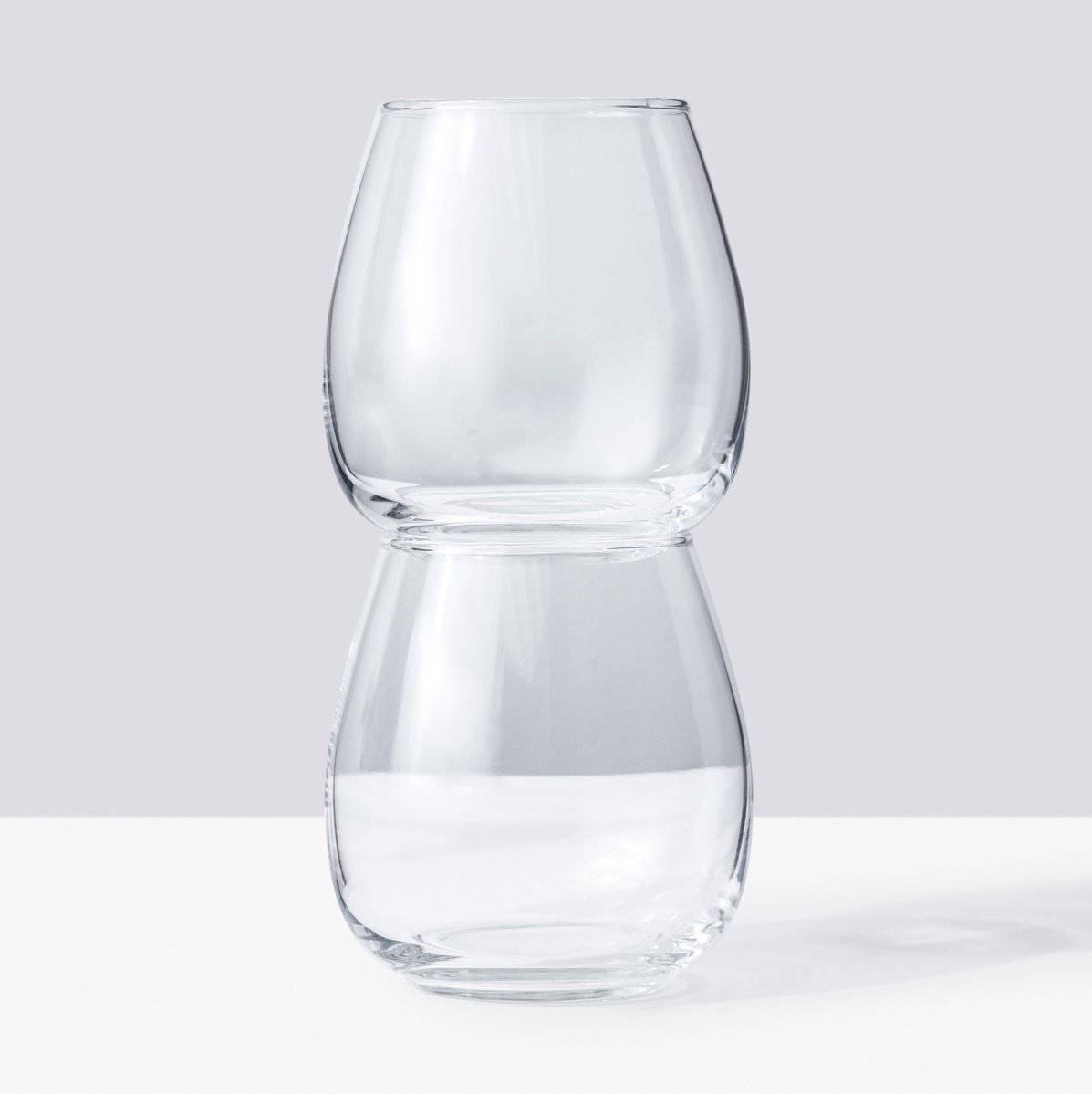 Two stemless wine glasses, stacked
