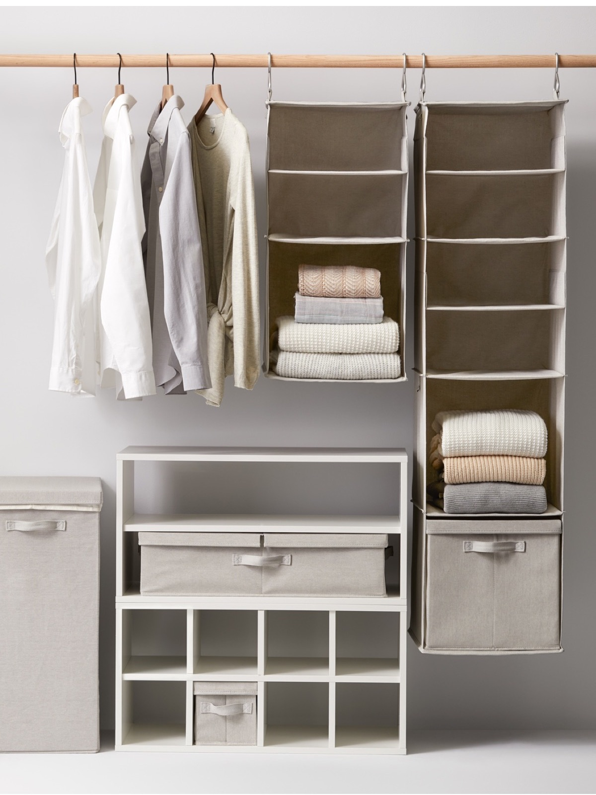 Closet featuring hanging storage, shelf, hamper and hanging dress shirts