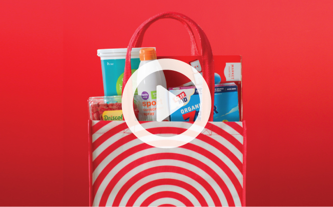 Red Target bag full of products, including fruit, yogurt, sunscreen, granola bars and popsicles