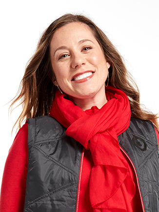 A head-and-shoulders shot of Adrienne against a white background