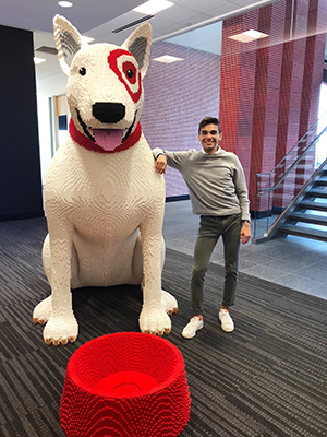 Max stands next to a giant statue of Bullseye the Dog made of LEGOs