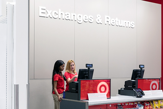 Two team members at the Exchange counter