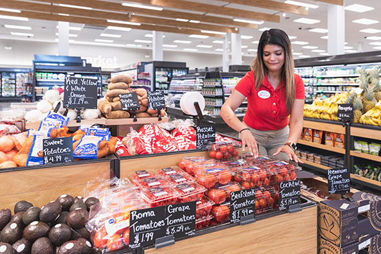 A team member working in grocery