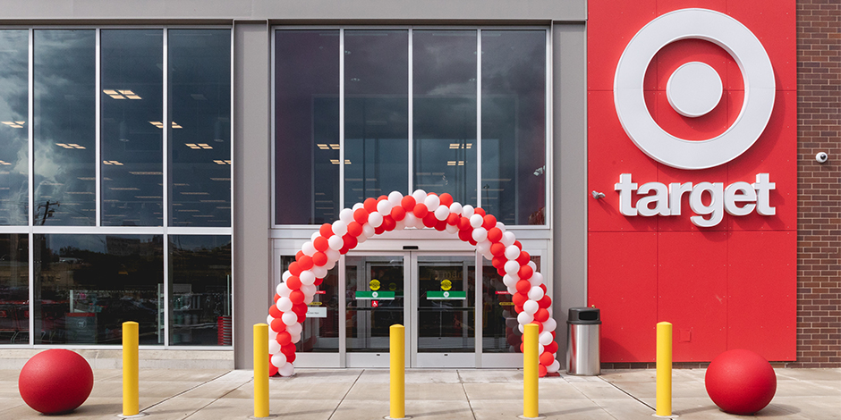 The outside of the new Philadelphia store with red and white balloons above the doors