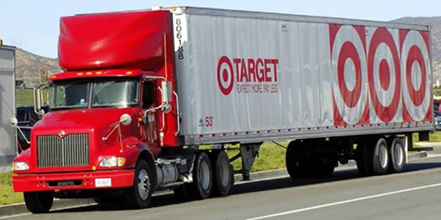 A red and white semi truck with Target's bullseye logo