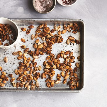 Sheet pan and bowl with toasted seeds