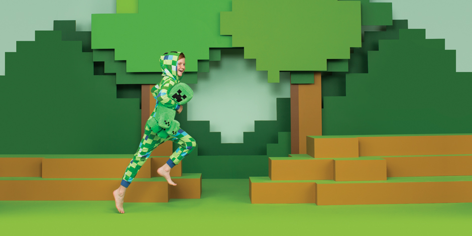 A child in Minecraft pajamas runs across a green brick background
