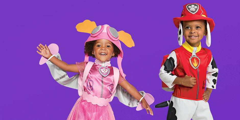 A boy and a girl in PAW Patrol Halloween costumes against a purple background