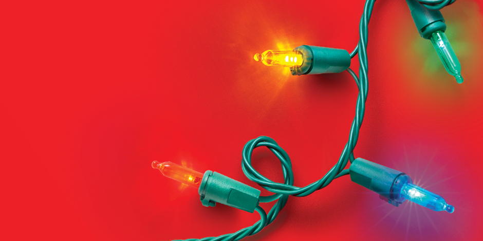 A string of colorful lights glows against a red background
