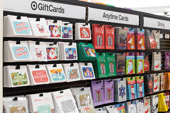 A close-up shot of several gift cards hanging on a display