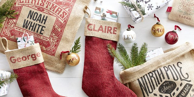 A variety of festive, personalized gifts, from stockings & ornaments to wrapping paper & gift sacks