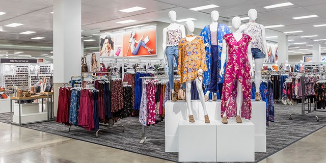 The women's apparel department with mannequins modeling colorful styles