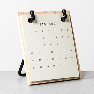 An easel calendar displays the month of January