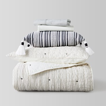 A stack of bedding and pillows