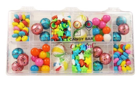 A clear plastic box with 12 containers filled with assorted colorful candies