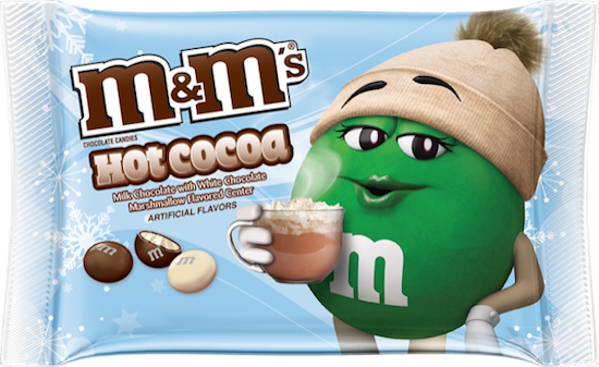 A package of hot cocoa M&M's with light blue background and green M&M with a tan hat and mug