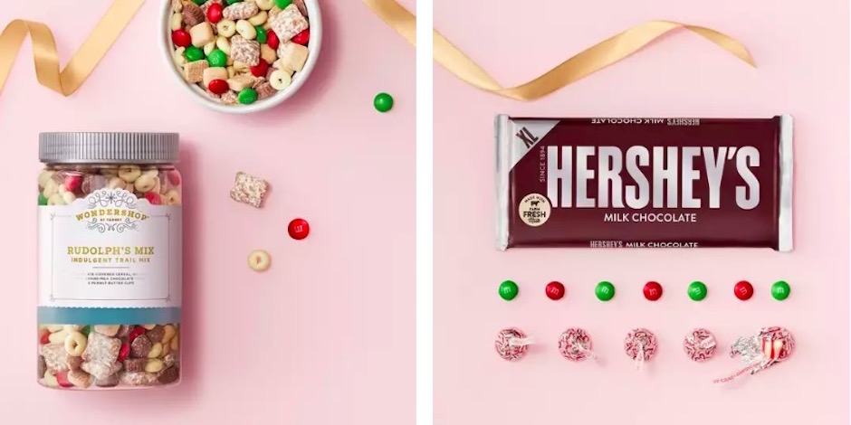 A jar and bowl of Wondershop trail mix and a Hershey's chocolate bar on a pink background