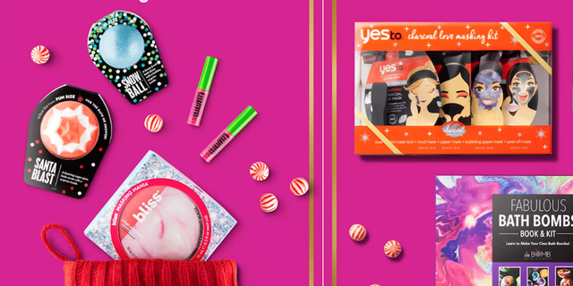 Beauty products including bath fizzers, masks and mascara with candy mints against a pink background