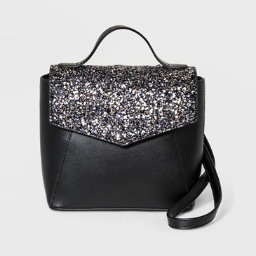 A black bag with sparkly silver flap with top handle and strap