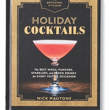 A black and gold book with cover photo of a red martini