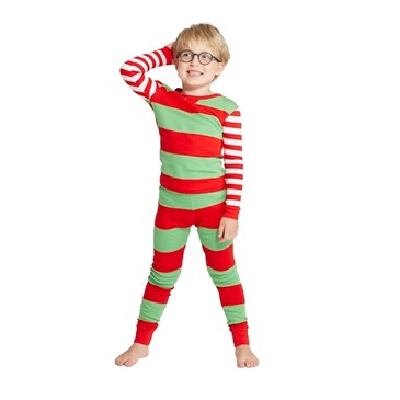 A child modeling a red and green striped pajama set