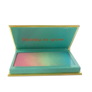 A teal blue package with yellow trim and rainbow highlighter palette