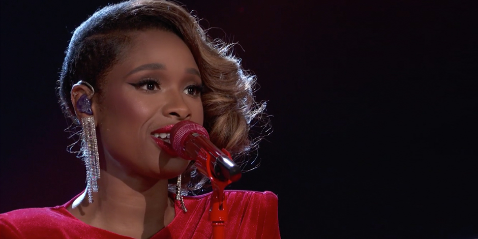 Jennifer Hudson sings into a red microphone