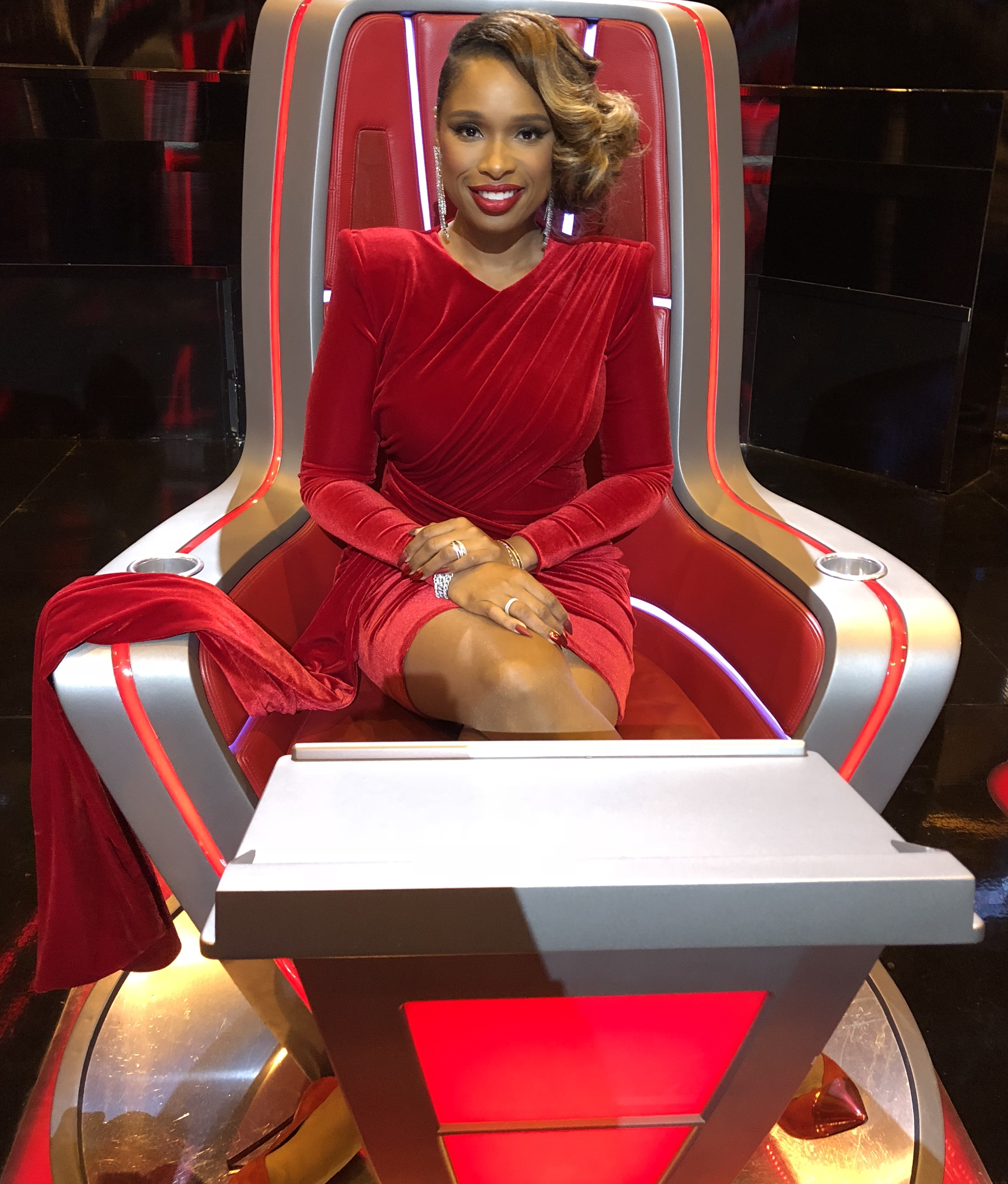 Jennifer Hudson sits in The Voice judge's chair