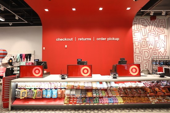 checkout counters with red and white mural
