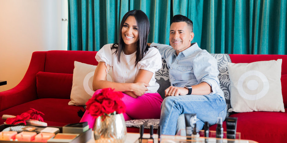 Karla Birbragher and Jorge Bernal sitting on a couch with Target product