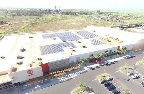 aerial view of store with solar panels on rooftop