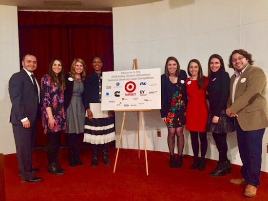 seven students stand with Laysha Ward at case competition event