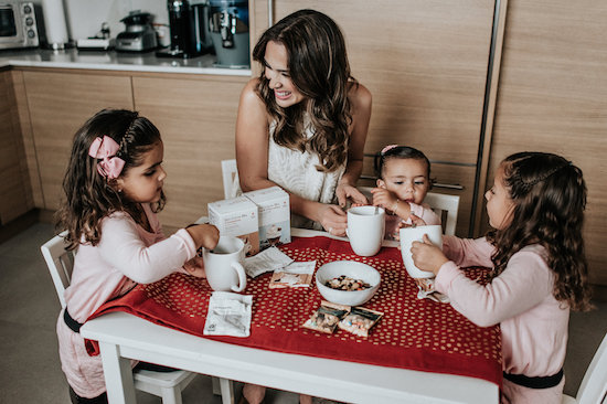 Jacky and her daughters making hot chocolate