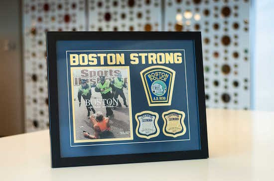 "framed award from Boston Police saying ""Boston Strong"""